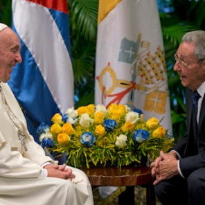 Pope Francis smiles as he visits with Cuba's President Raul Castro, in Havana, Cuba, Sunday, Sept. 20, 2015. Francis thanked Castro for his welcome at Havana's airport on Saturday and for the Cuban president's pardons for 3,522 prisoners convicted of relatively minor crimes, in their exchange before a private meeting. (Ismael Francisco/Cubadebate Via AP)